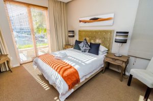 Double bed with patio and view of canal